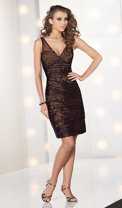 Sleeveless lace over taffeta knee-length sheath with crisscross front and back V-necklines