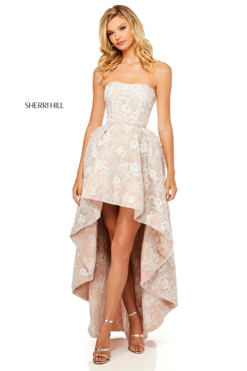 Style 51684 from Sherri Hill is a sheer high low prom